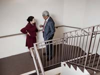 Woman and man in stairwell - new EEOC ruling 2012