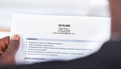 Person Reading Resume, How To Improve Your Resume