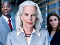 An older woman in front of younger workers, age discrimination quiz