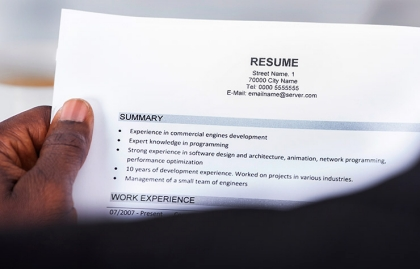 person reading resume how to improve your resume