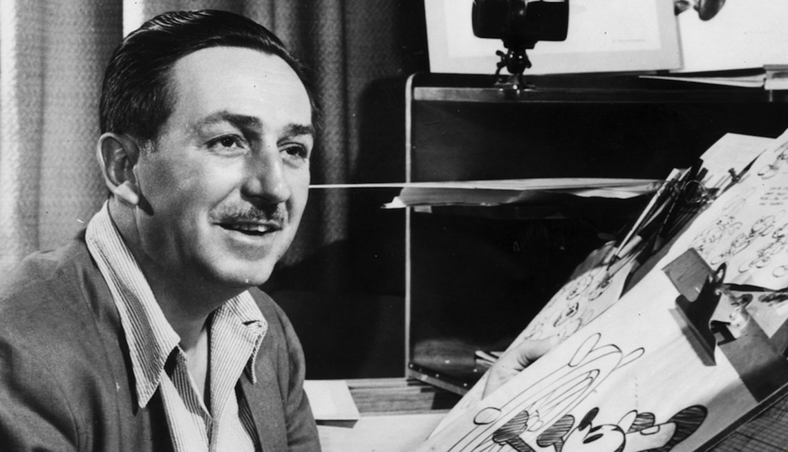 Animator Walt Disney at the drawing board