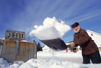 A Maine resident shovels out his mailbox.