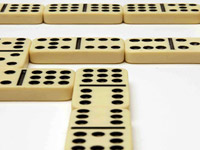 Dominoes connect the dots to consider taking a 401(k) as an annuity