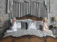 A couple discussing money management in the their bedroom before getting married.