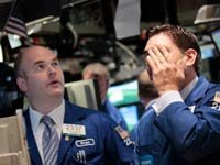 stock market plunges over 400 ppoints two days after the budget deficit legislation was signed-two stock brokers react badly to the downward spiral in the market