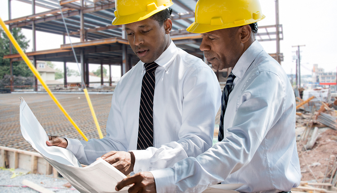 two african americans work at a construction site
