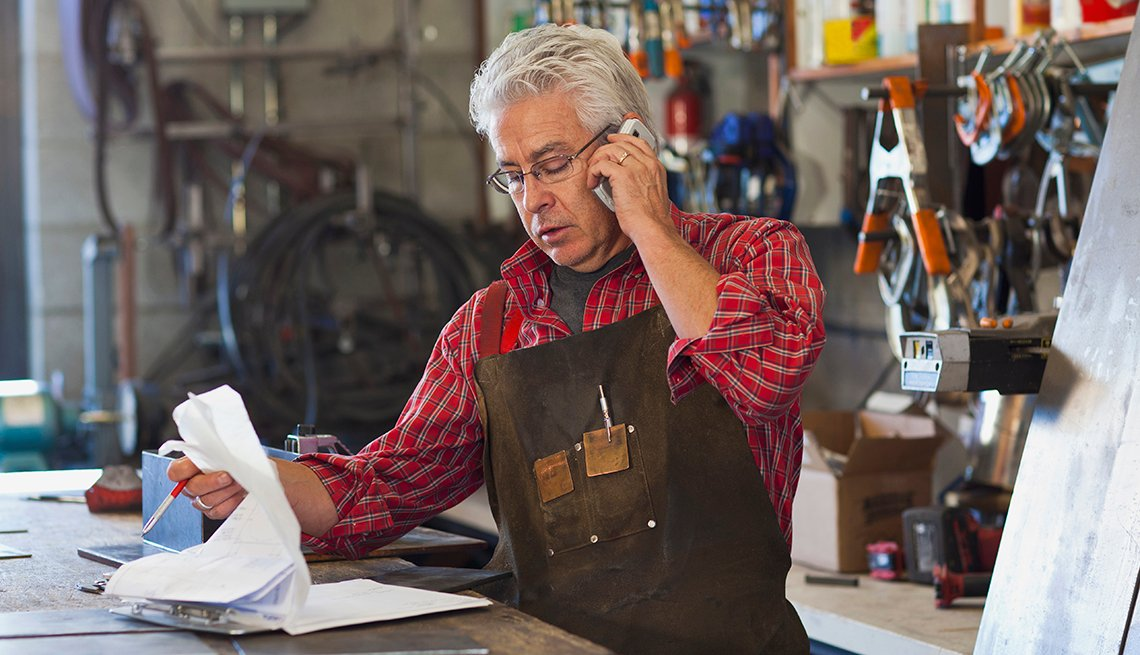 Older adult male working at a shop