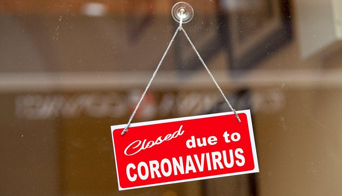 Señal en un negocio que anuncia su cierre por coronavirus.