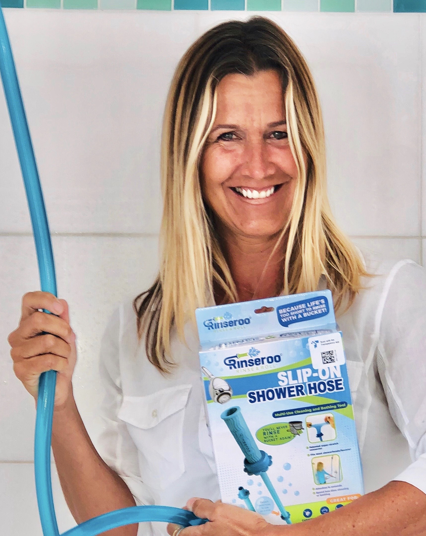 entrepreneur lisa lane poses with her slip on shower hose product