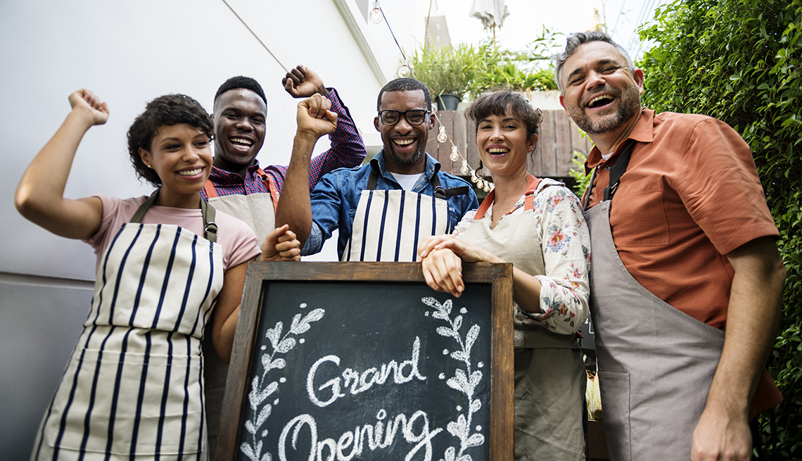 a group of people celebrate the opening of their business