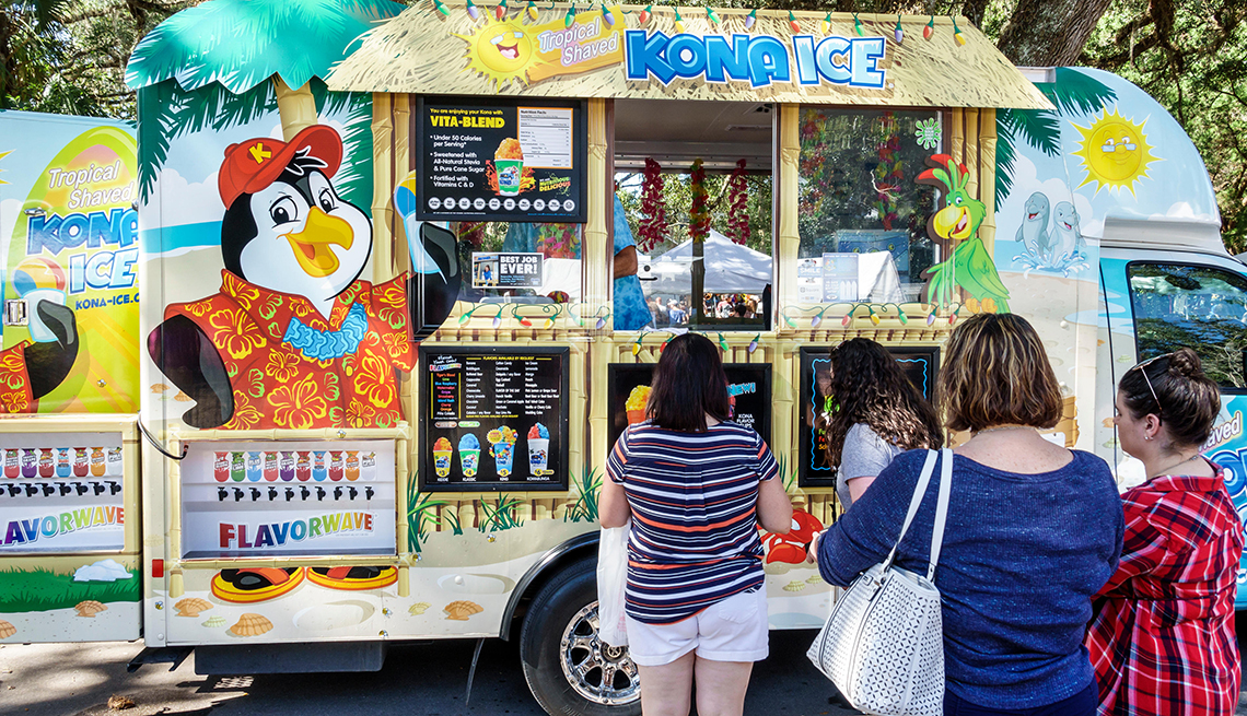 People waiting in line at a kona ice truck