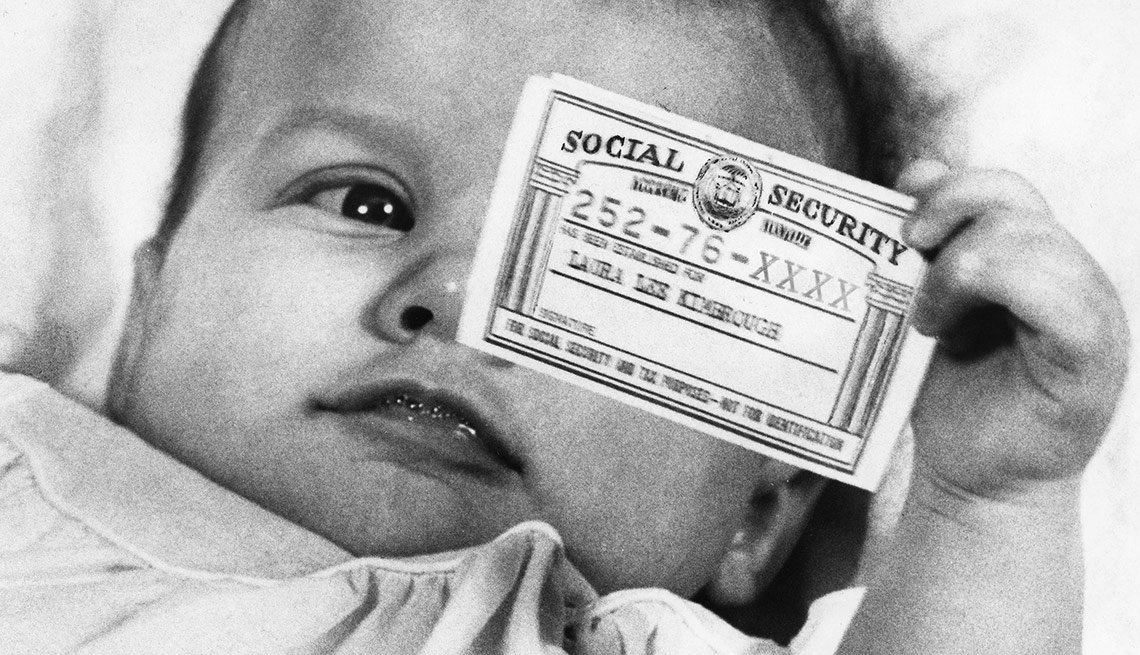 SOCIAL SECURITY, 1963. A three-month-old infant from Atlanta, Georgia, holding the Social Security card that was issued to her after an aunt had bought stock in her name, 1963. Image digitally altered to conceal last four digits of Social Security number.