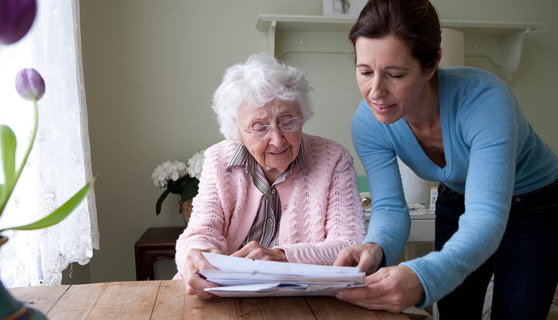 A responsible payee helps an elderly woman with Social Security finances.