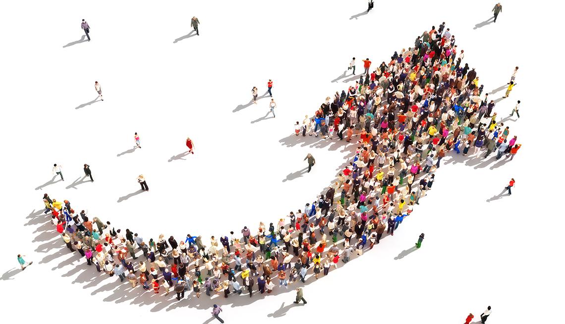 Flecha apuntando hacia arriba y hecha con personas