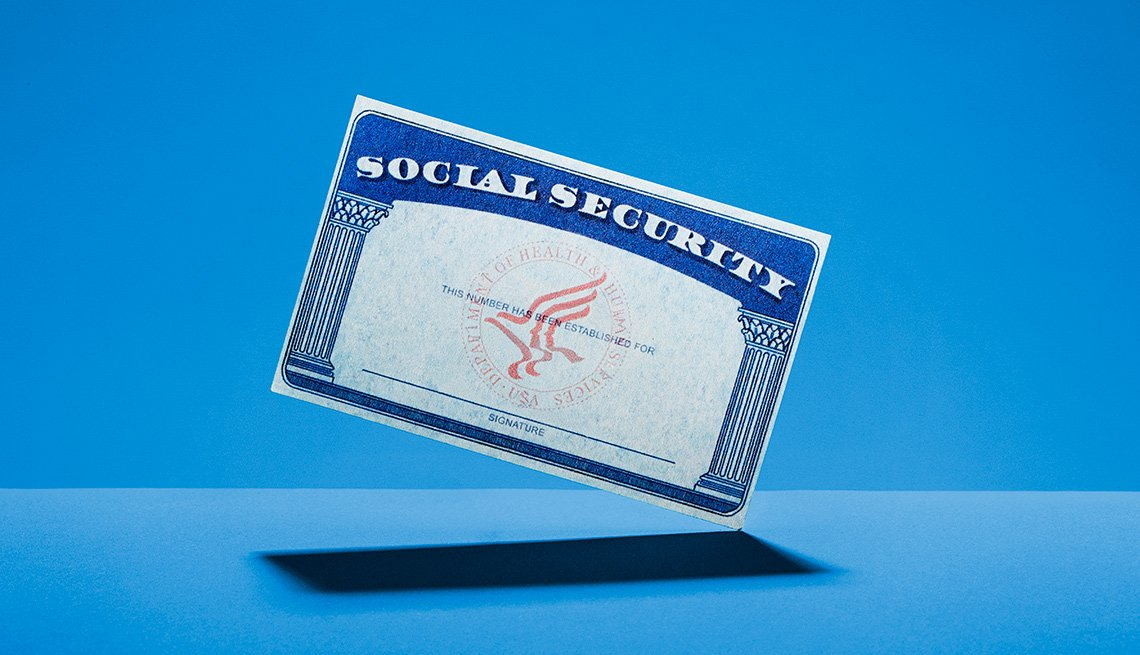 suspended social security card on a blue background