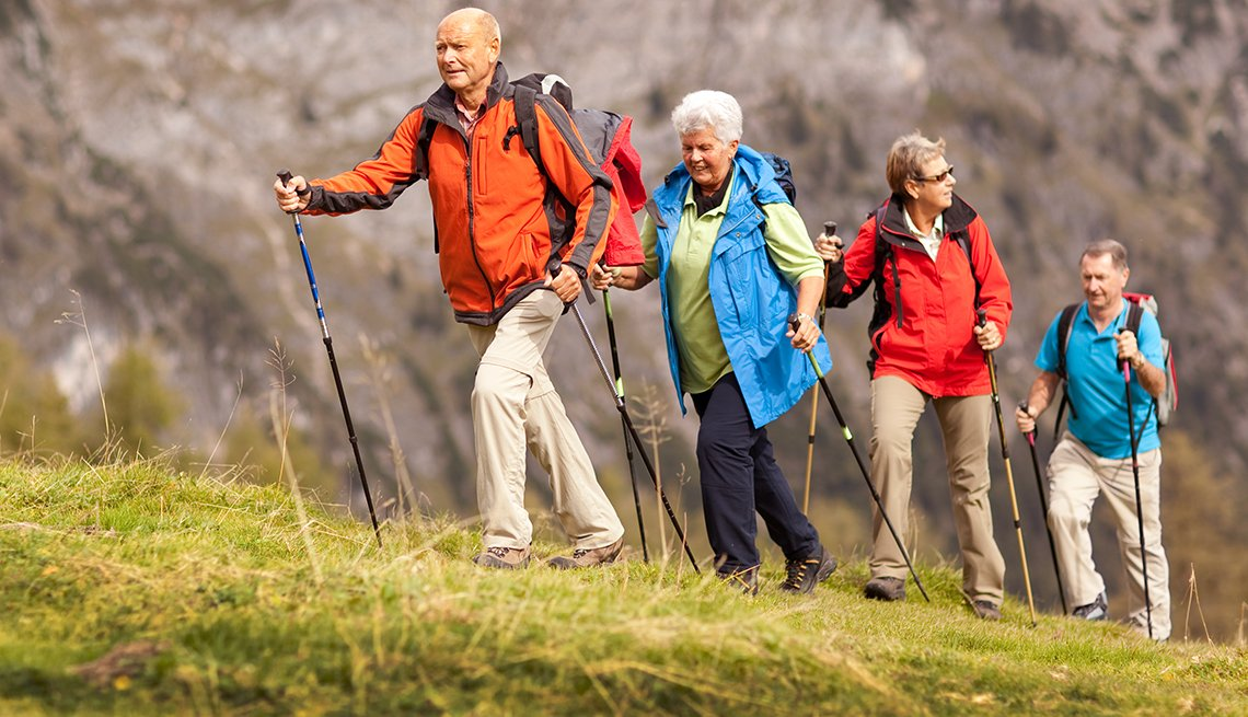 group of mature adults walking in nature