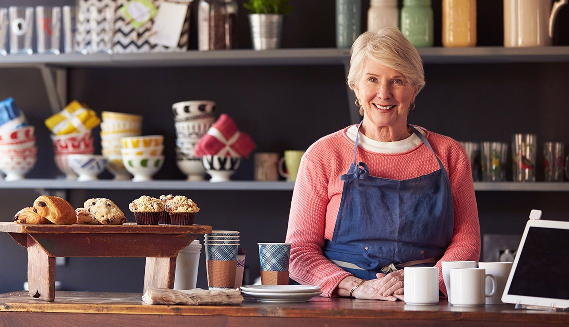 Mature woman working in coffee shop