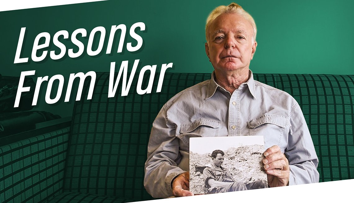 Man holding picture with text on image that  reads Lessons From War