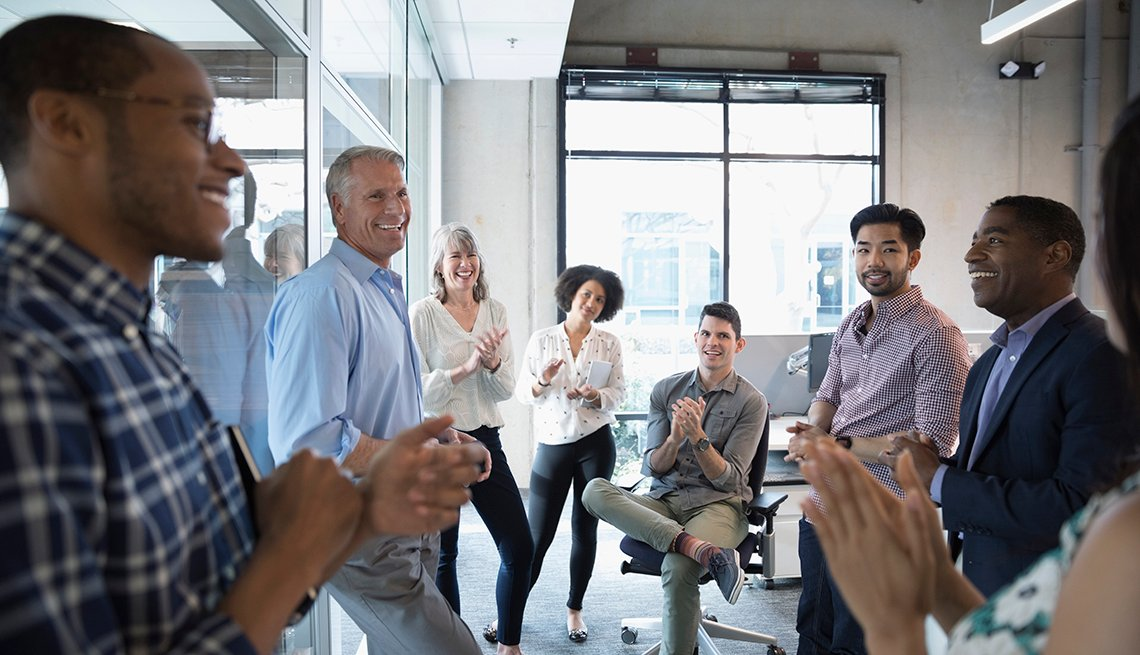 group of people standing in an office
