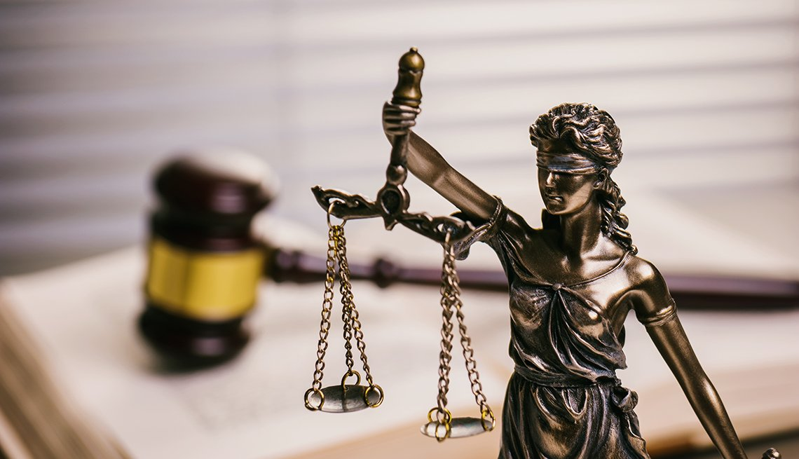 A statue stands in front of a gavel