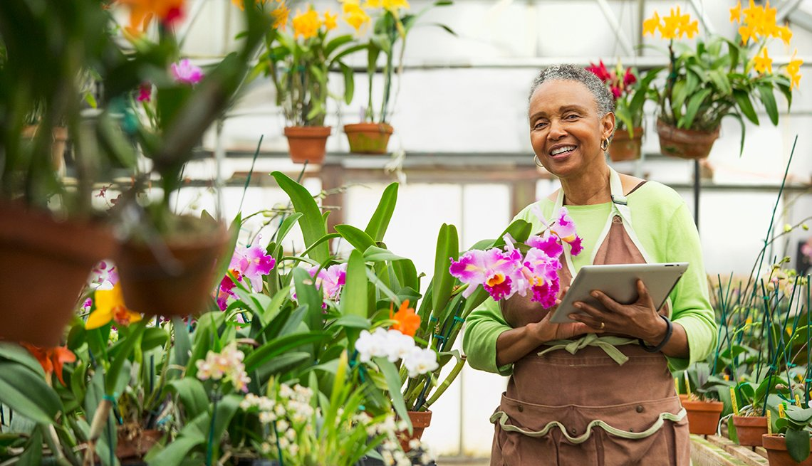a female gardener in a greenhouse