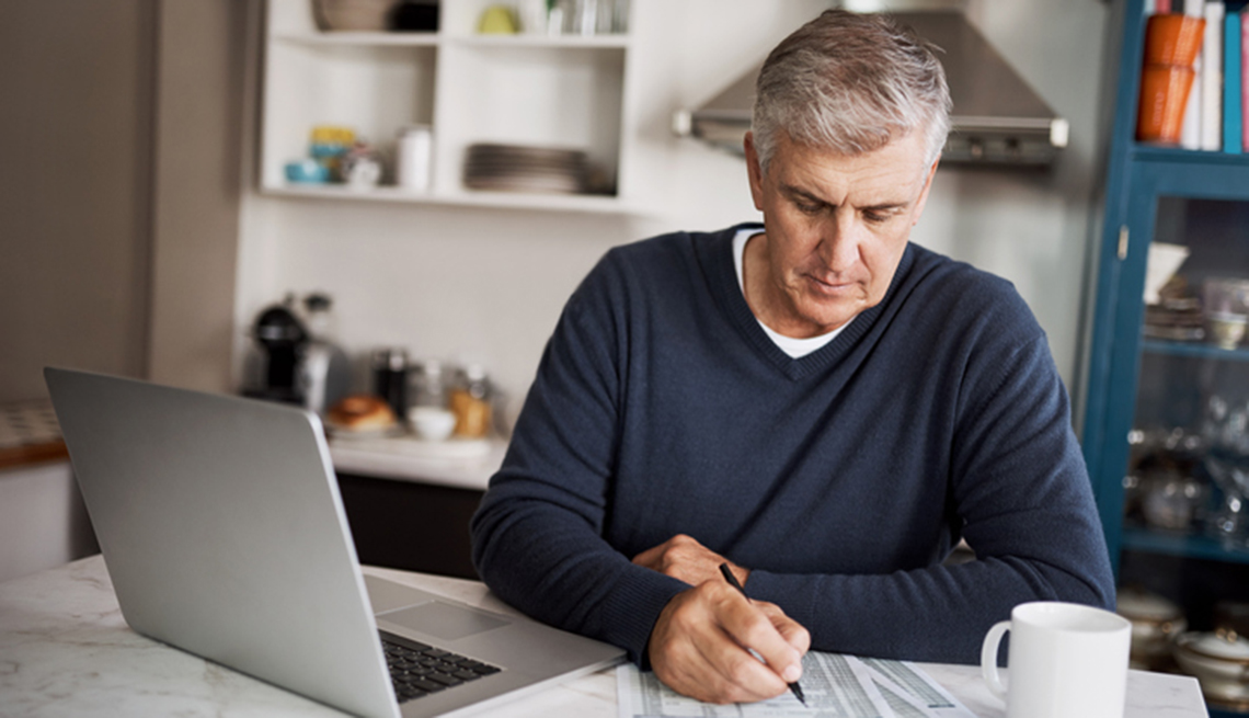man in front of a computer