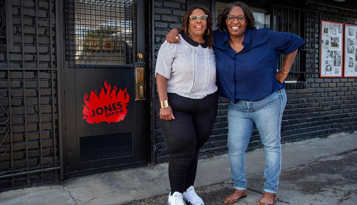 Jones sisters in front of their B B Q place.