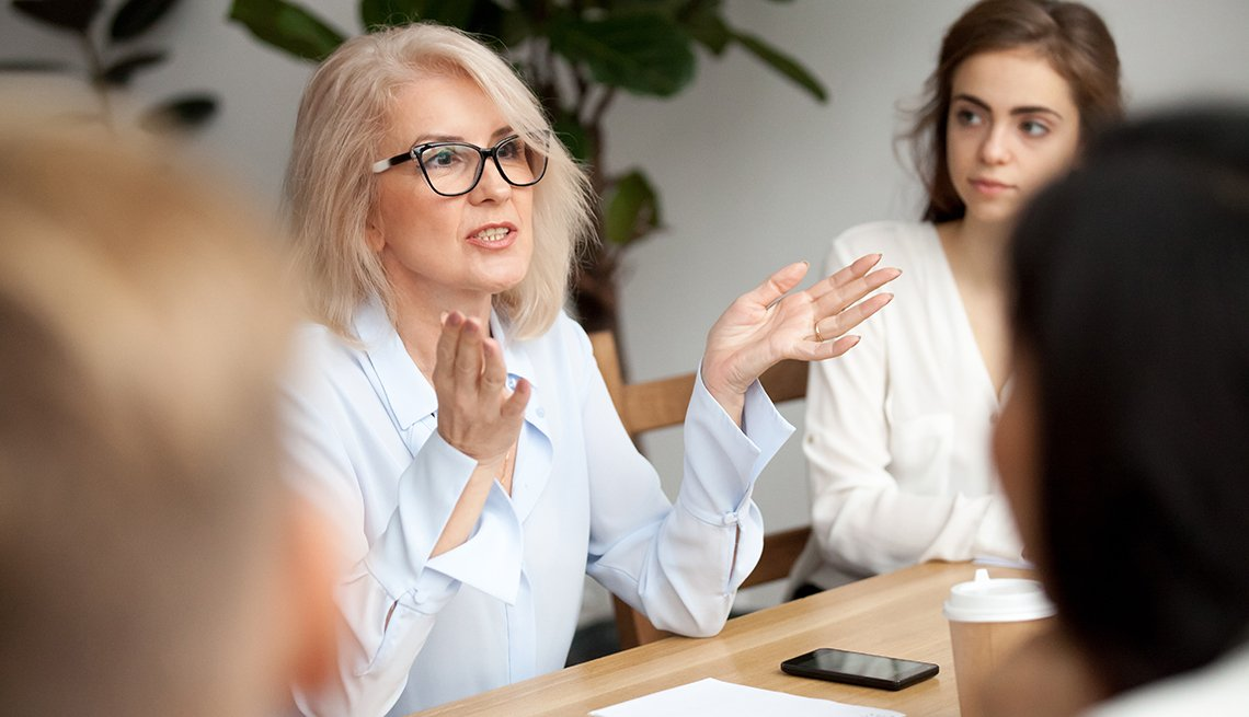 a woman talks in a meeting