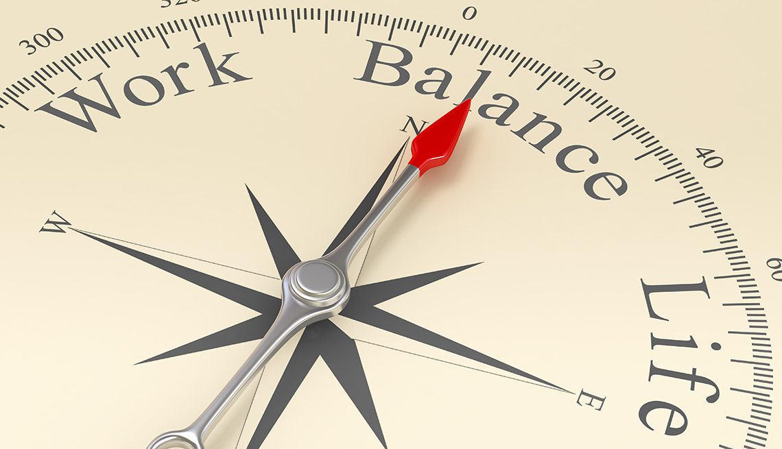A compass that says work life balance