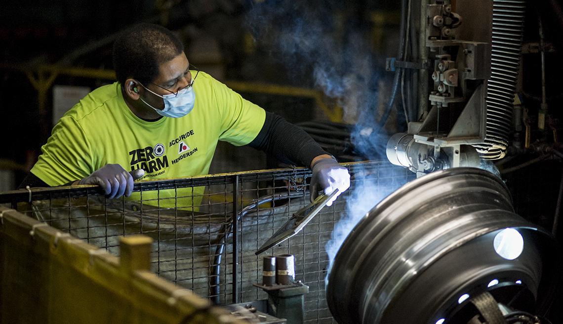Tryone Garnett at work at a Whirlpool factory