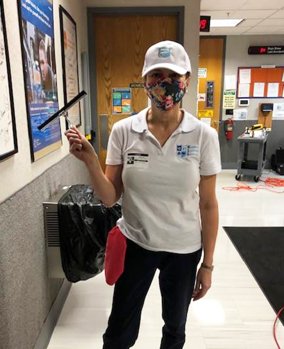 elaine brauch holds a squeegee at work
