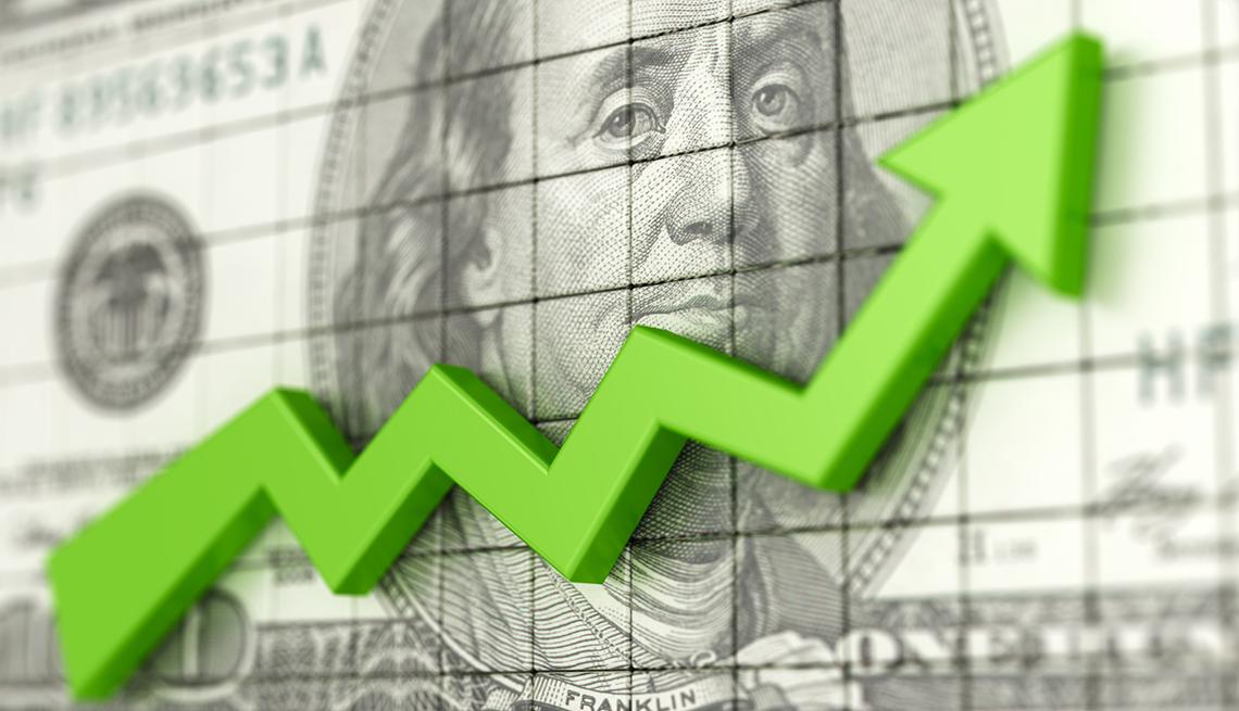 Línea verde hacia arriba frente a un billete de <img00 dólares