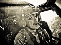 Chief Warrant Officer Walter R. Jones pilots a Black Hawk over the mountains of Afghanistan.
