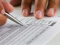 hands filling in a tax form
