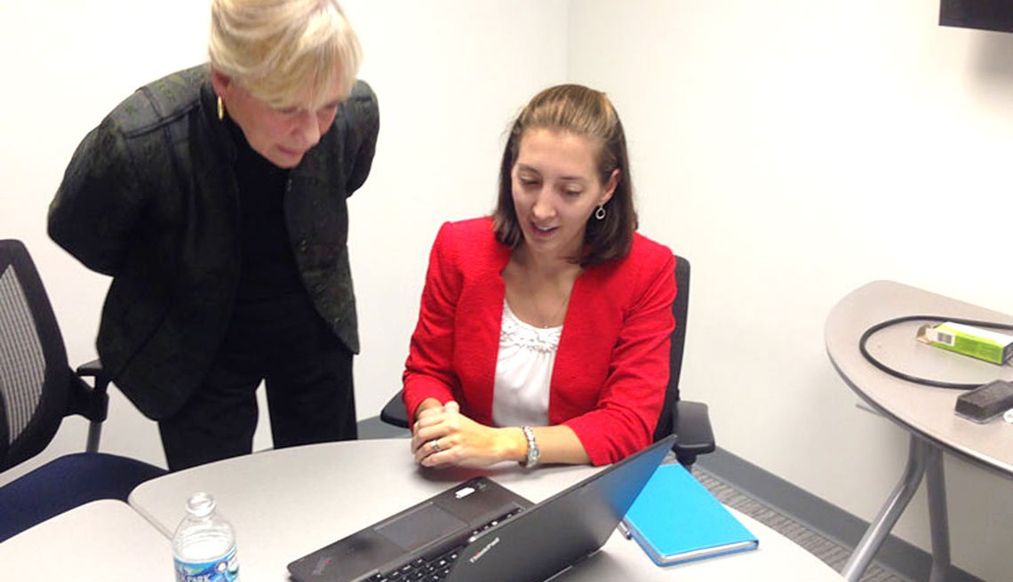 Alexandra Minor (right) reviews financial projections with volunteer business consultant Carolyn Stirrett.