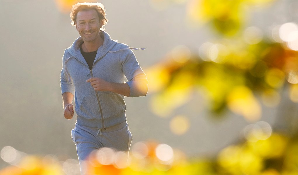 Mature man jogging in forest