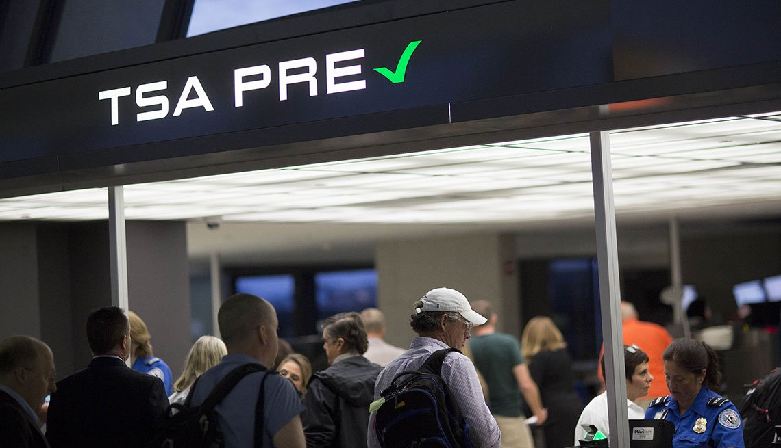 TSA Passengers stand in the Transportation Security Administration (TSA) pre-check line at an airport