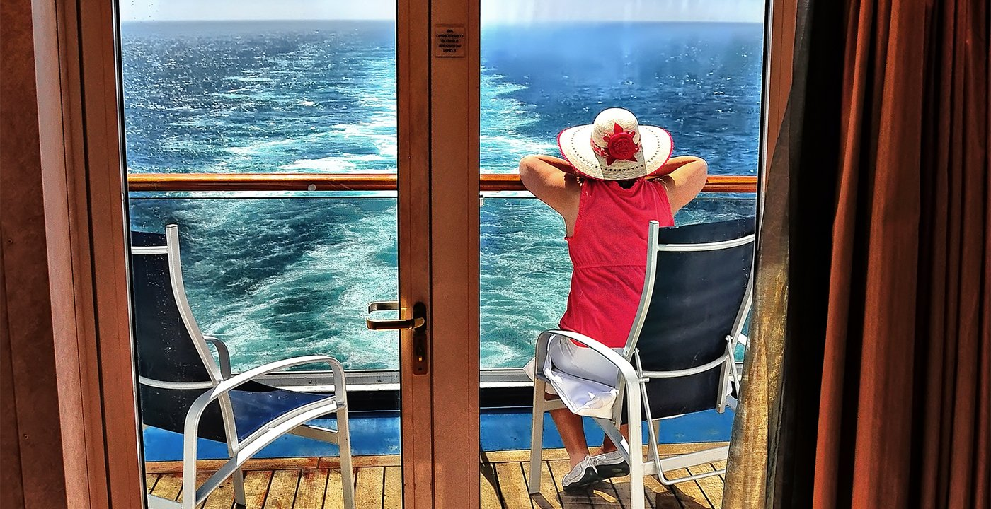 Woman on her cruise ship balcony