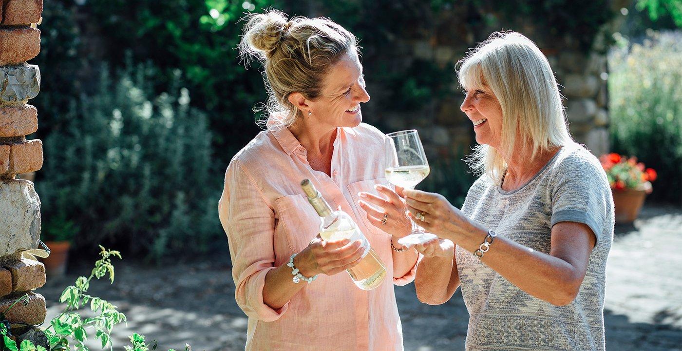 Two women tasting wine