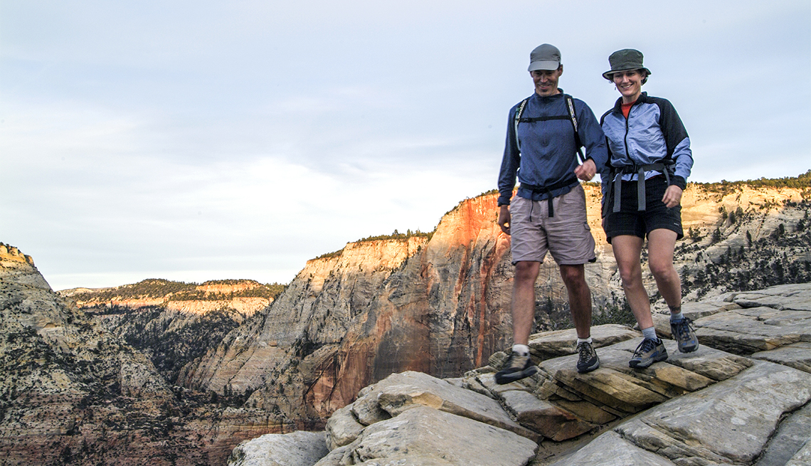 Man and woman hiking in Zion National Park