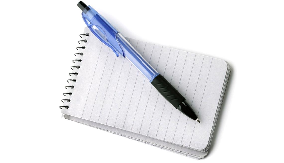 Libreta de notas y bolígrafo
