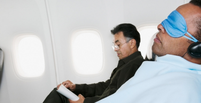 Man sleeping during a flight.