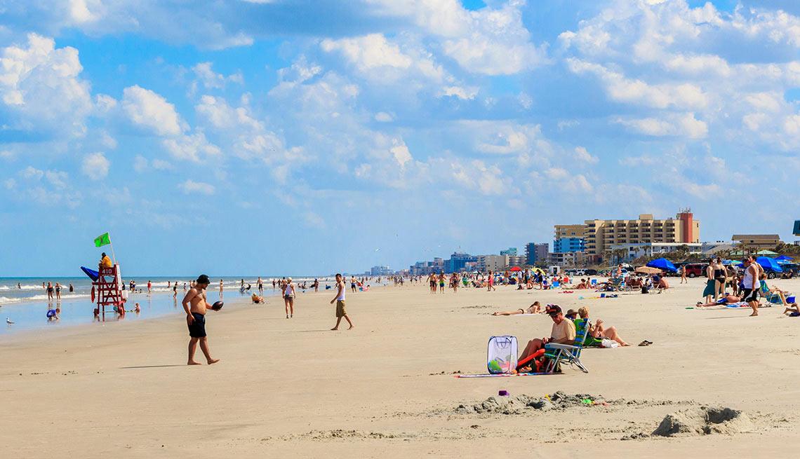 Tourists on beach New Smyrna Beach, Florida