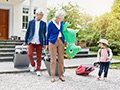 Grandparents and little girl driving individual carry-ons, Samantha Browns Tips for Buying Luggage