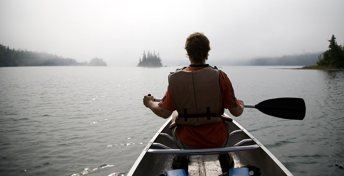 Canoer in Isle Royale , 9 Under-the-Radar National Parks for Summer