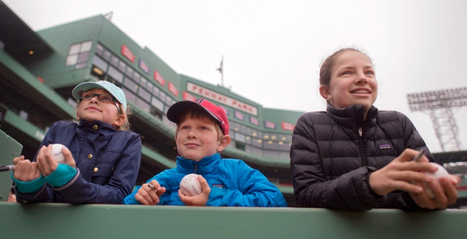 Fans look for autographs at Fenway Park in Boston, MA