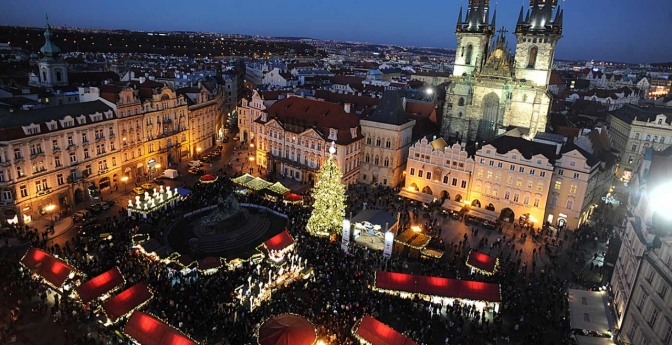 See the illuminated Old Town Square with the Christmas market in Prague.