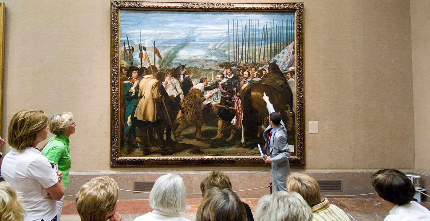 Tour guide and tourists looking at La Rendicion de Breda by Velazquez in the Museo del Prado, Madrid, Spain